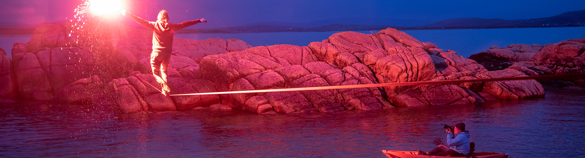 balancing on tightrope with flare signal